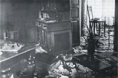 Photo of inside Ipatiev house after Bolsheviks departed . July 24, 1918. Oven in corner and belongings strewn all over floor.