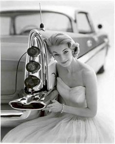 Model with a DeSoto, 1950s. Remember when all car ads had to have a blond girl in a strapless dress?  Some things change for the better.  But where are my fins? #cars #fins