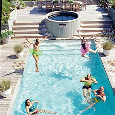 Family fun centers around this rectangular pool complete with a built in deck at the top and a hot tub. coastalliving.com