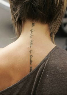 ohmygosh:  Victoria Beckham has excellent taste in love poetry. This is the Hebrew tattoo on her back:  אֲנִי לְדוֹדִי  וְדוֹדִי לִי  הָרֹעֶה בַּשּׁוֹשַׁנִּים  Translation:  I am for my beloved and my beloved is for me who browses among the lilies. The phrase comes from the Song of Songs in the Hebrew Bible.  I have always wanted this, but hard to find some one-whom can write Hebrew.