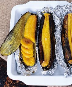 Baked Plantains Recipe—Plantains look like bananas, but they're much starchier, and therefore do a terrific job of filling in for potatoes (even if they aren't as crunchy as chips). This recipe from Elizabeth Gordon, author of Simply Allergy-Free, has you Haitian Food Recipes, Cuban Recipes, Jamaican Recipes, Vegetarian Recipes, Cooking Recipes, Healthy Recipes, Snacks Recipes, Dominican Food Recipes, Jamaican Dishes