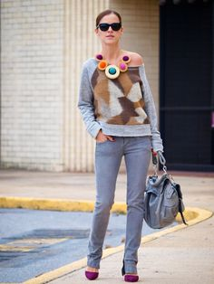 statement necklace and purple pumps with sweater and gray jeans