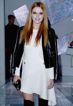 Fancy footwear: The 16-year-old actress sported a pair of thigh-high stiletto boots, with ...