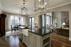 12950 Queensbury Ln. Island Kitchen is the focal point of the room & features a Shaw Farmer's Sink, honed Granite Counters, Carriage Lamp lighting & fabulous open feel. Bernstein Realty, Houston Real Estate.