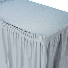 Transform the look of any table with the  Silver Plastic Table Skirt. Each of the 29 inch high x 14 feet long silver plastic table skirts has an adhesive backing for easy hanging.