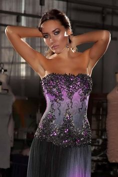 abe296f17c5 Flatter your figure and show off your shoulders in this fitted corset top.  It s the