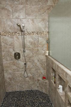 There is nothing more luxurious than a walk in shower. We wanted to make the shower unique by adding built in shelving and unique tiling on the floor and trim.