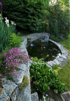 Koi pond in the garden - typical extra for the Asian and tropical inspired ambienceGarten & Pflanzen - Garden Design Ideas