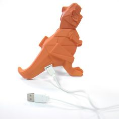 Add some oriental inspired design to your home with this mini Origami style orange dinosaur desktop lamp.This lamp can be plugged into a computer keyboard via a USB connection to bring the comfort of a soft, friendly light while studying or working! It will also stand alone on a shelf or bedside table. The lamp is orange in colour and combines clean cut lines and cubist shapes to create a classic Tyrannosaurus Rex movie dinosaur, standing tall on his hind legs and roaringand fits in the… Desktop Lamp, Tyrannosaurus Rex, Great Birthday Gifts, Unique Lighting, Stand Tall, Antique Art, Bedside, Studying, Computer Keyboard