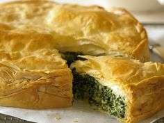 Golden filo pastry filled with lemony spinach and feta cheese and fragrant with dill and mint, this pie is a winner.