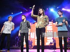 Singers Niall Horan, Liam Payne, Harry Styles and Louis Tomlinson of One Direction perform during the 6th Annual 99.7 NOW! Triple Ho Show at SAP Center on December 2, 2015 in San Jose, California.
