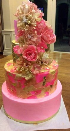 Edible wafer paper and fondant wedding cake in pink and gold with edible gold leaf and hand made wafer paper flowers by The End Dessert Comp...