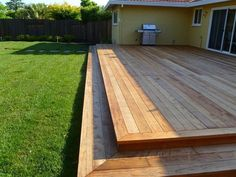 Low deck with two steps. I love how this is simple, level and runs nearly the le. Low deck with tw Large Backyard Landscaping, Backyard Patio, Backyard Ideas, Patio Decks, Wood Decks, Wood Patio, Deck Pergola, Cheap Pergola, Best Wood For Decks