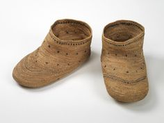 Hollow-core grass and straw stalks provide excellent insulating properties and as materials are used commonly for outdoor winter footwear or as inner liners.  This pair of grass socks with blue thread embroidery were worn in the early part of the 20th century in the Aleutian islands.  Grass socks were commonly worn by Alaskan Aleuts  inside their boots to protect their feet from moisture.