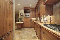 Country+kitchen+with+walnut+cabinetry+and+rustic+decor