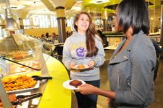 State Quad: Smiling is contagious when students peruse the dessert section. Cookies, brownies and cakes, oh my!