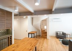 Reclaimed white oak flooring and tabletops in a Brooklyn, NY apartment.