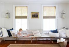 end-to-end camp cots create a long daybed or window seat