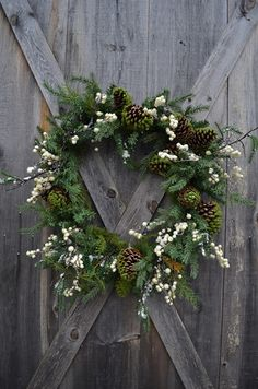 something like this for the winter shoot- so pretty, a wreath on a beautiful barn door. ideas sarah?!