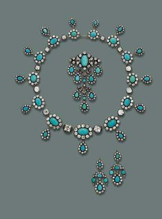 This parure was given to Princess Maria José of Belgium as a wedding present from her parents. Consisting of a necklace designed as a series of graduated oval turquoise and old-cut diamond clusters, each suspending a similar drop to the diamond collet spacers, the six main diamonds can be unscrewed; a pair of bracelets with detachable clasps, can be worn as a choker; a pendent brooch and two pendants en suite, mounted in silver and gold.