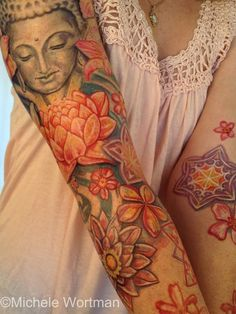 Michele Wortman floral tattoo  I'd want something like this for my mom too...Her two favorite flowers are blue roses and lotus blossoms