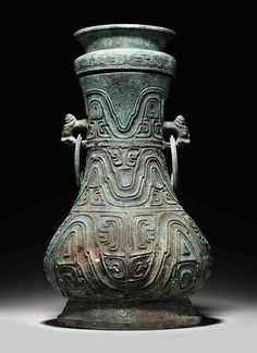 A RARE LARGE RITUAL BRONZE WINE VESSEL AND A COVER, HU MIDDLE WESTERN ZHOU DYNASTY, CIRCA 9TH CENTURY BC