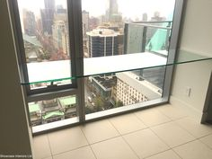 A floating tempered glass desk we installed overlooking downtown Vancouver.
