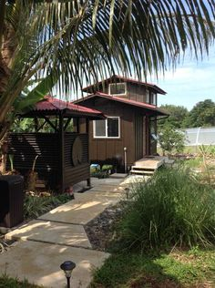 Entire home/apt in Hana, US. This is the sweetest tiny home cottage in paradise you'll ever see.  Our cottages are located on an organic, off the grid, farm sanctuary. The whole 2.5-acre fruit farm, including both cottages, are fully run by the power of the sun.    We are loc...