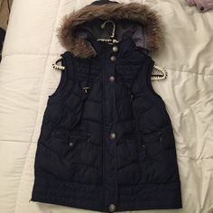 Mossimo Supply Co. Vest Jacket Very comfortable blue vest jacket. Little bit of red. It zips & buttons. It has fur in the hood. Short sleeve. Two pockets in the front. Only been worn once. Mossimo Supply Co. Jackets & Coats Vests