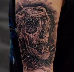 Skull lion's head tattoo