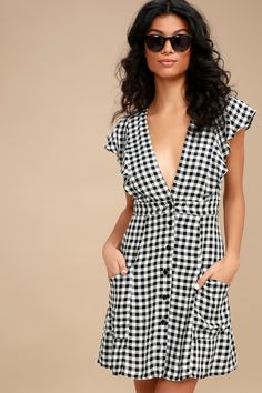 Put on the Lost + Wander Day Trip Black and White Gingham Mini Dress and go for a cruise with the top down! Woven fabric is light and breezy across this adorable gingham dress with a plunging V-neckline, ruffled bodice, and fluttering short sleeves. Banded waist tops a button-front mini skirt with side pockets.