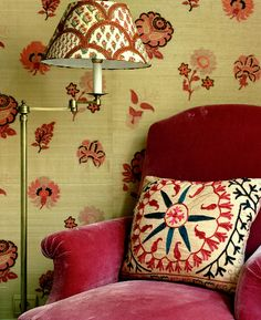 Love the contrasting patterns and how the pink chair brings everything together.