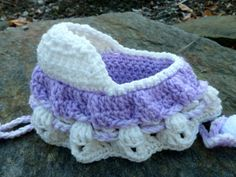 Crochet cradle that turns into a purse.  I remember that I had a blue one of these, complete with a baby inside.