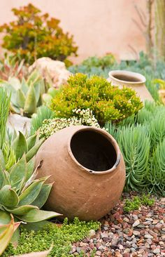 Mexican pots create interest at the California residence's front door.