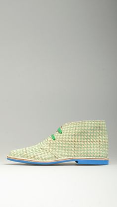 Houdstooth green suede lace-ups desert boots featuring contrast dark green cotton laces, desert boots manufacturing process, antioxidant eyelets, polka dot embellished lining,  leather midsole, raw edge stitching, contrast blue rubber sole, 100% finest suede and split grain leather.