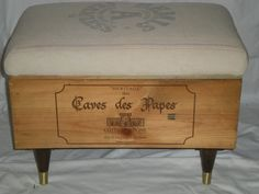 I like the IDEA of this wine crate ottoman using a french vintage fabric. I would've chosen different legs...but that's just me. I could also see the crate as a coffee table filled with wine corks and a glass top on large industrial castors .