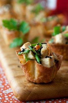 Sesame Chicken Wonton Cups Appetizer-8 ounces boneless, skinless chicken breast  cooking spray  24 wonton wrappers, about 6 oz.  2 tablespoons tahini  2 tablespoons soy sauce or tamari sauce  2 tablespoons maple syrup  2 tablespoons mayonnaise  ½ cup thinly sliced snow peas  ½ cup shredded carrot  ½ cup thinly sliced scallions  2 tablespoons chopped basil and/or cilantro  black sesame seeds for garnish, optional