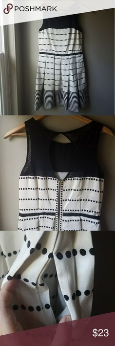 Ann Taylor Black & Cream Party Dress Size 10 Gorgeous Ann Taylor fit and flare dress. Sheer illusion mesh collar, metal zipper, lined skirt, POCKETS and built in belt. EUC. Size 10. Ann Taylor Dresses Midi
