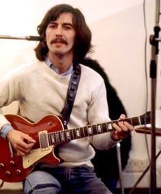 "George and his Gibson Les Paul ""Lucy"" given to him by Eric Clapton and used to record ""While my Guitar Gently Weeps"""