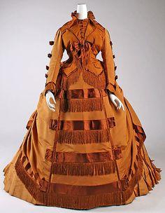 1867–71 dark orange fringed dress