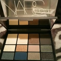 NARS Issist L'Amour Eyeshadow Palette New TWELVE SHARP Matte, shimmer, and style. Everyday neutrals meet eight accents in this full-spectrum wardrobe of curated shadows. Set Features:? I - Cream Bisque? II - Shimmering Pink Sand? III - Amethyst Ash? IV - Black Truffle? V - Golden Starlight? VI - Sunburst Copper? VII - Caf? Au Lait? VIII - Pistol Grey? IX - Industrial Steel? X - Regal Blue? XI - Shimmering Taupe Cashmere? XII - Shimmering Liquorice  Brand new!!! NARS Makeup Eyeshadow