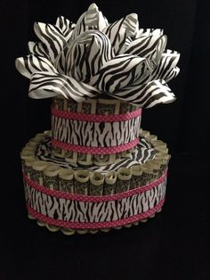 Money Birthday Cake. Made this cake out of $50 one dollar bills, cardboard, and ribbon. I was also able to fill the inside with candy. Great for birthday, grad parties, or anything else.