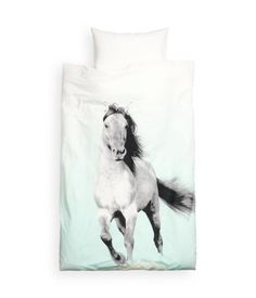 move over sparkly cat tshirts...majestic horse duvets are the new hotness