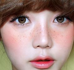 doll face, freckles.