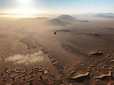 """Up in the sky for an hour of pure magic, and coming down to an """"Out of Africa"""" champagne breakfast in the Namib Desert. Namib Desert, Out Of Africa, Wish You Are Here, Dune, Wilderness, Safari, Country Roads, Sky, Mountains"""