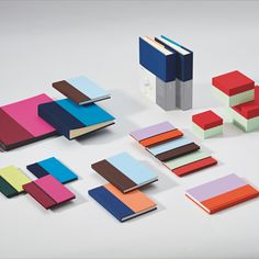 """Based on the bookbinding practice of half-linen or half-leather binding, we developed a contemporary and sleek product line for the brand Semikolon over the last 2 years. Divided in a """"golden ratio"""" and wrapped in a fresh two-tone color scheme, it presents notebooks, photo albums and boxes for storing those things closest to your heart. Those things you want to keep. The word mark has been given an overhaul and underscores the quality of the products and what the brand represents."""