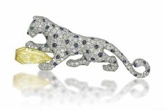 A coloured diamond, sapphire and diamond panther brooch, by Cartier.Photo Christie's Image Ltd 2013