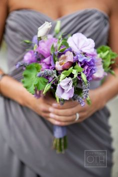 grey bridesmaids dresses with purple and green flowers