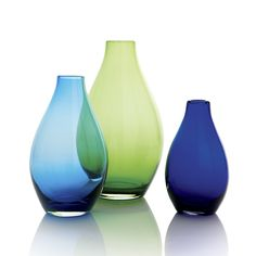 Cased glass shapes a teardrop of a vase. Gather all three sizes of the Salena vase for a luminous display of cool color.