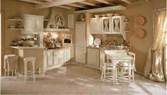 cucina crema  con sgabelli